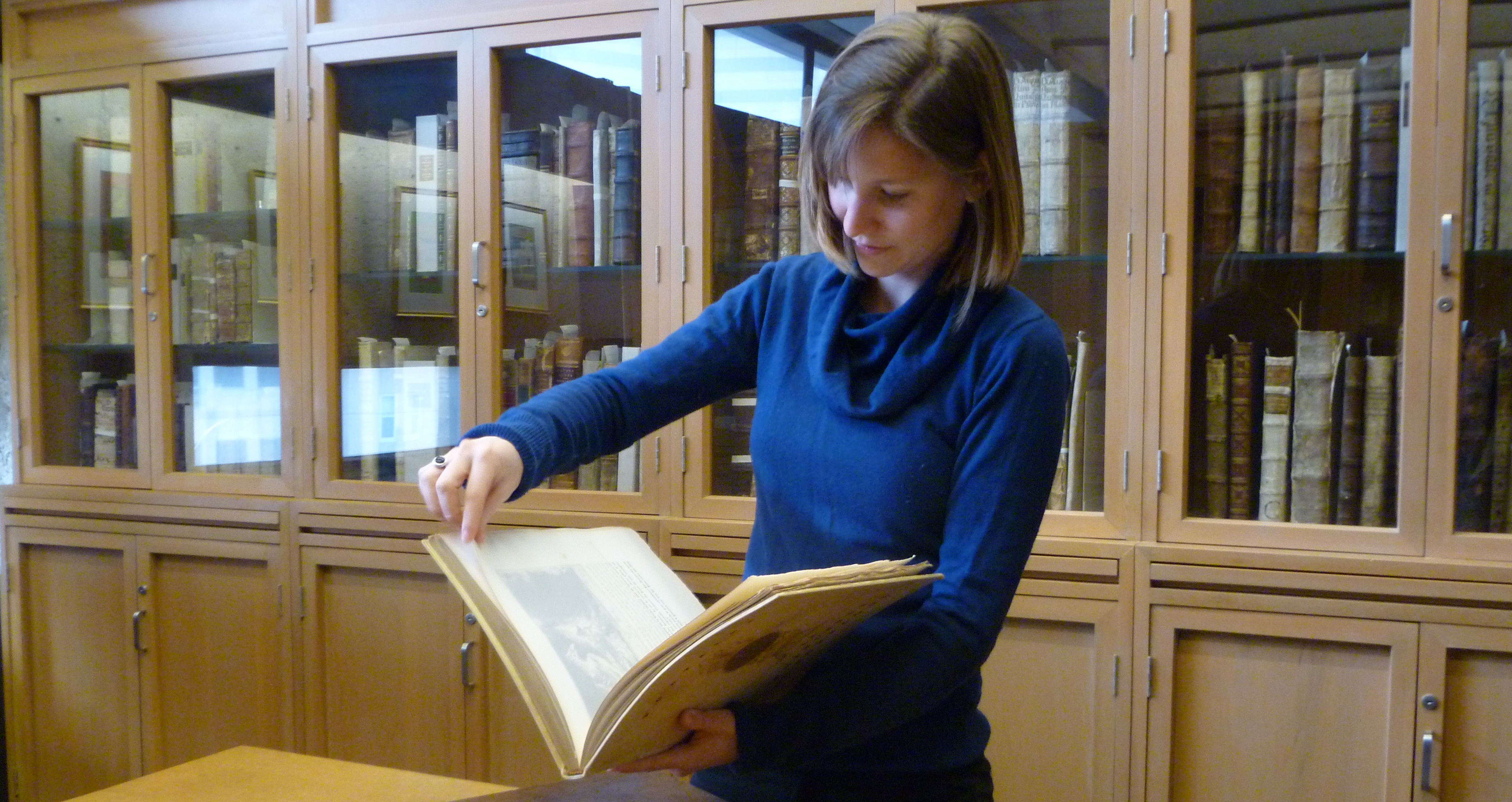 Enssib intern Élise Breton working with rare material, Rare Books & Special Collections Library.