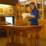 Enssib intern Elise Breton working with rare materials in Rare Books & Special Collections