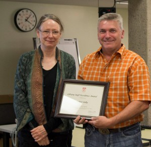 Dean of Libraries Colleen Cook presents Robert Selby  with the 2015 Staff Excellence Award / Photo credit: Merika Ramundo