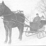 A horse-drawn sleigh, circa 1920.