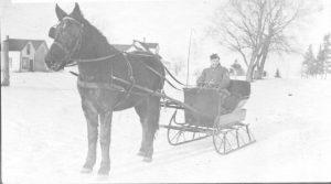 A horse-drawn sleigh, circa 1920