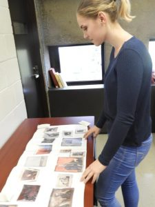 Figure 4: Visual Arts Collection intern, Tara-Allen Flanagan, looking over preliminary plans for the painting display in the Visible Storgae Gallery.