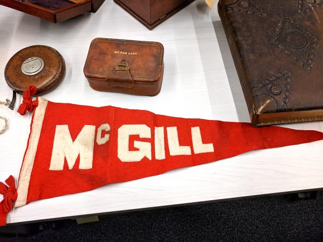 Archival McGill memorabilia, including a flag