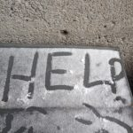 Help written in snow outside McLennan-Redpath