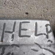 Help written in snow outside McLennan-Redpath