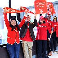 Image of McGill staff holding archival flags/ promotional materials