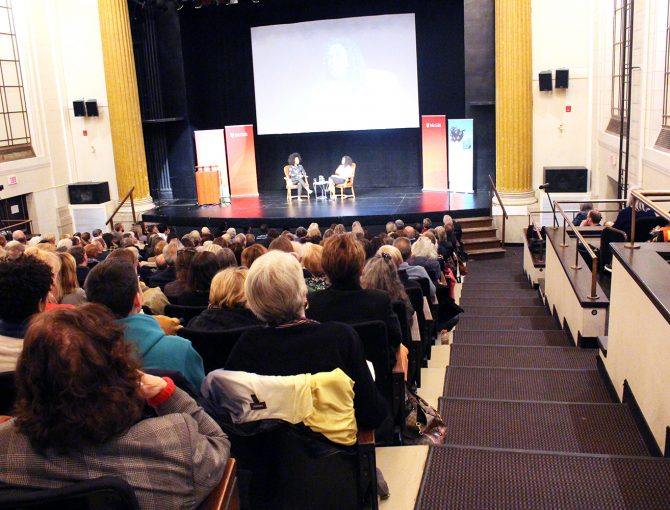 Amanda Parris and Esi Edugyan on stage at the 2019 MacLennan Lecture in front of packed audience