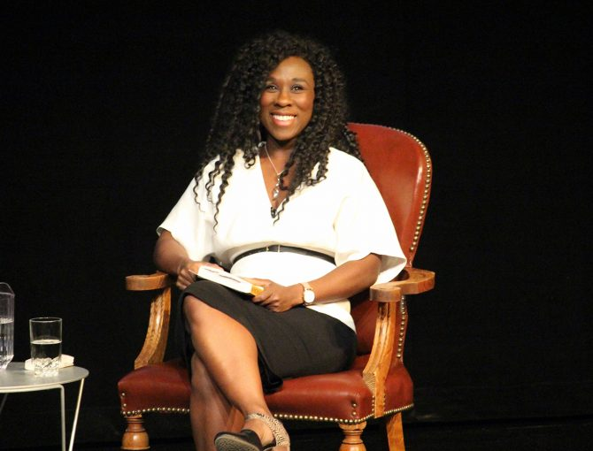 Author Esi Edugyan smiling onstage at the 2019 MacLennan Lecture