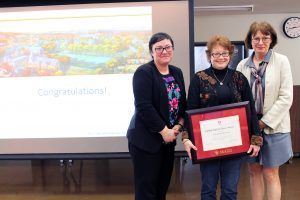 Last year's winner, Merika Ramundo (left), Elizabeth Thomson (middle) and Dean Colleen Cook (right)