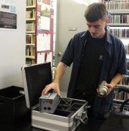 Rowan Grice working with AV equipment