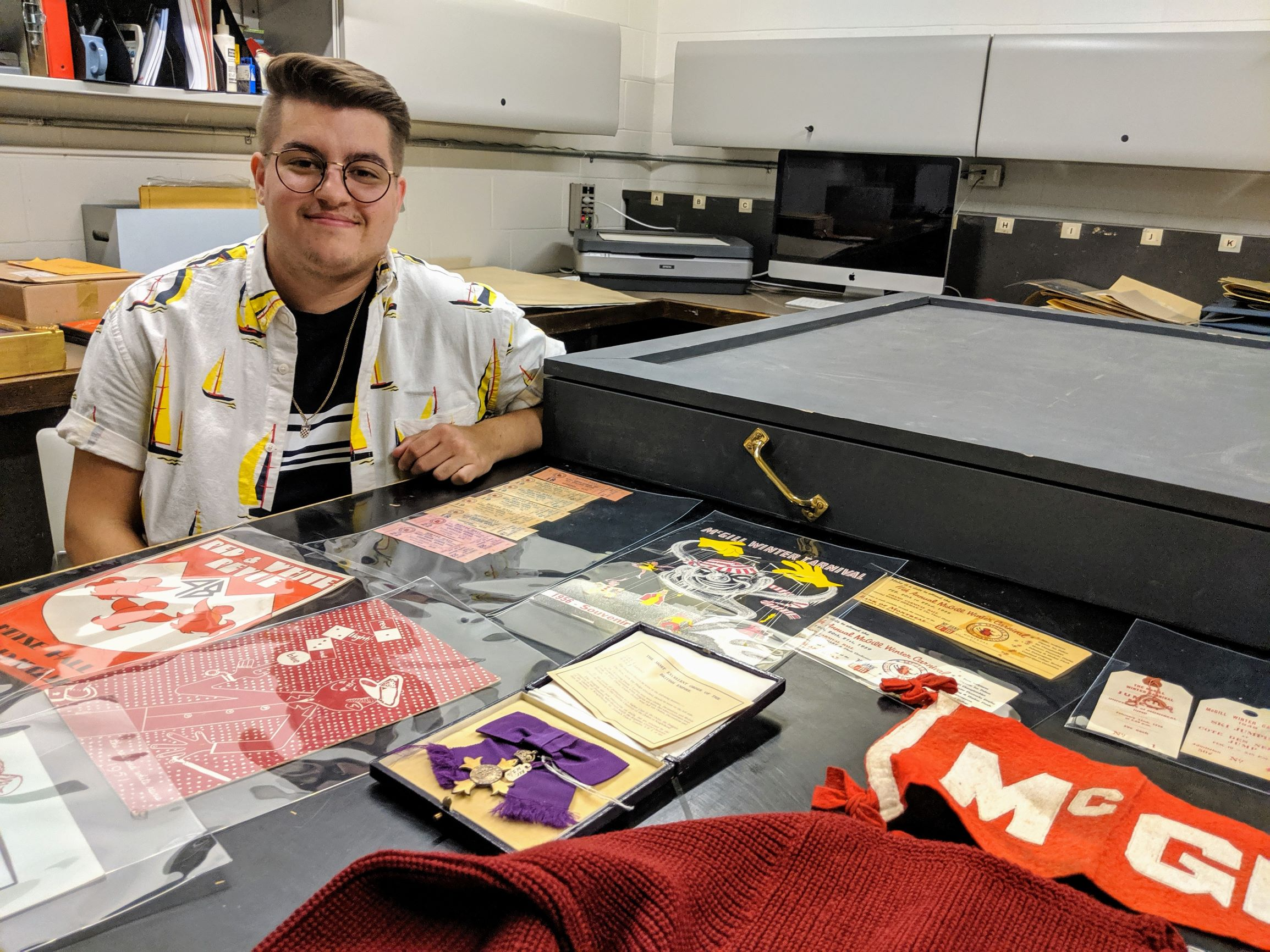 Nikolas Lamarre with items from McGill's archival materials.