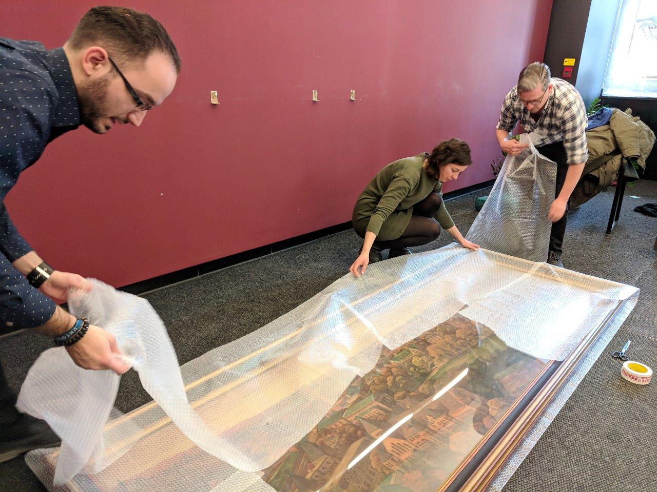 Staff wrapping the Nobbs in bubble wrap before the move. Photo: Merika Ramundo
