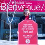 Dean Colleen Cook wearing a red McGill24 hat, holding a red McGill24 poster.