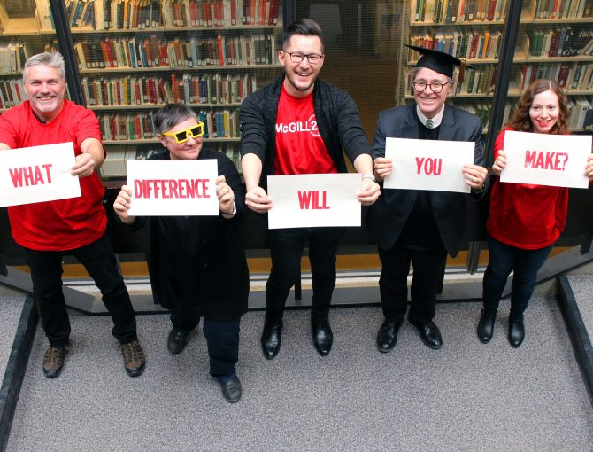 """Five Library staff seen from above holding signs that spell out """"What Difference Will You Make?"""""""""""
