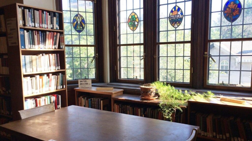 Birks Reading Room tables, with sun streaming through stained glass windows