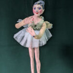 ballerina string puppet on a green backdrop