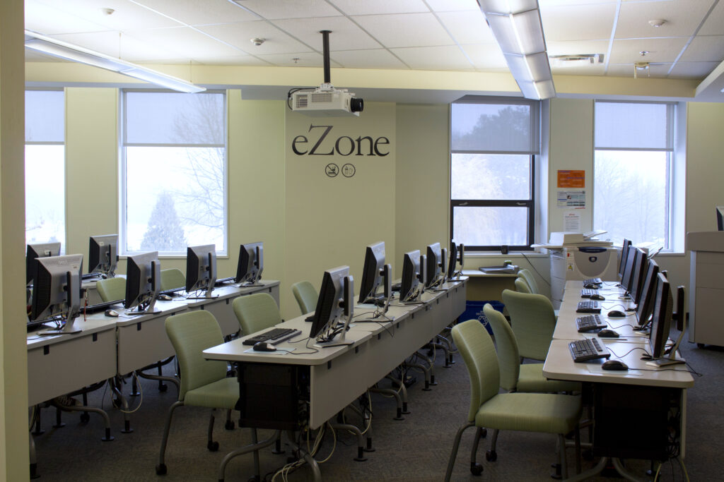 Mac Campus Library eZone filled with computer stations.