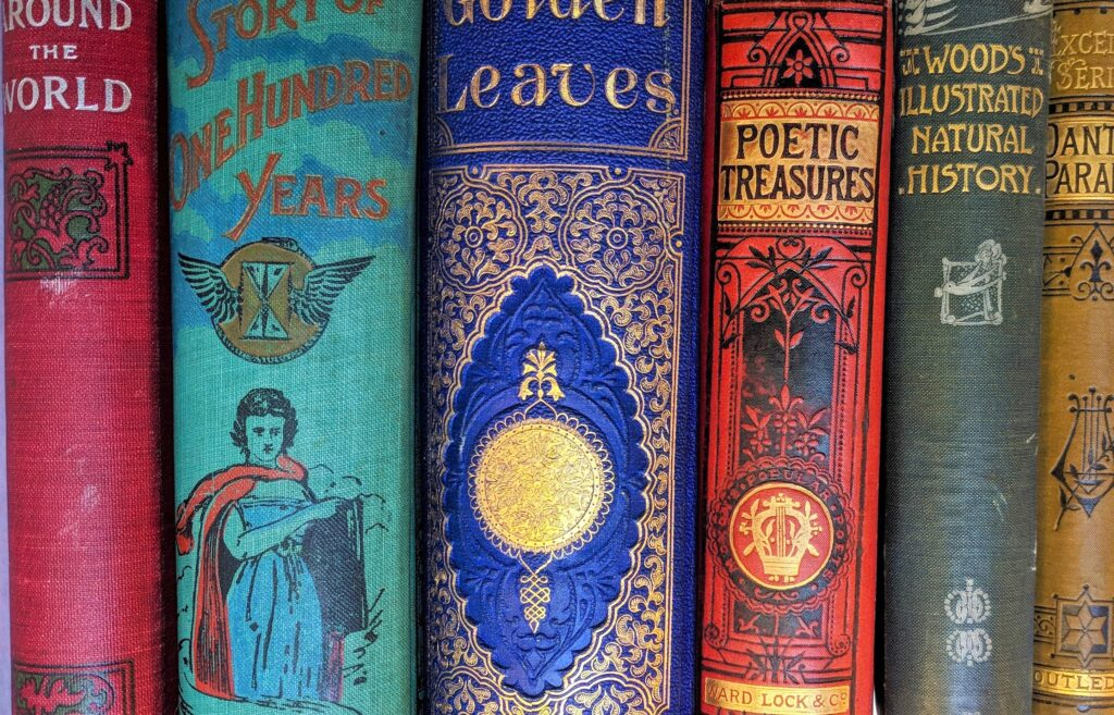Close-up of five colourful rare books.