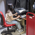 Helen Qin in the Digitization Lab