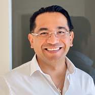 Francisco Oliva smiling.